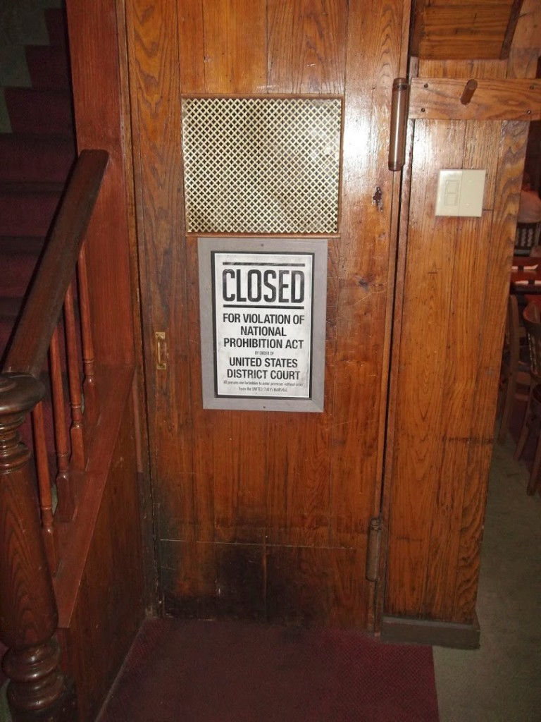 The door leading downstairs into the basement speakeasy, the most haunted room in the tavern. (HERALD PHOTO/Ryan LaBo)