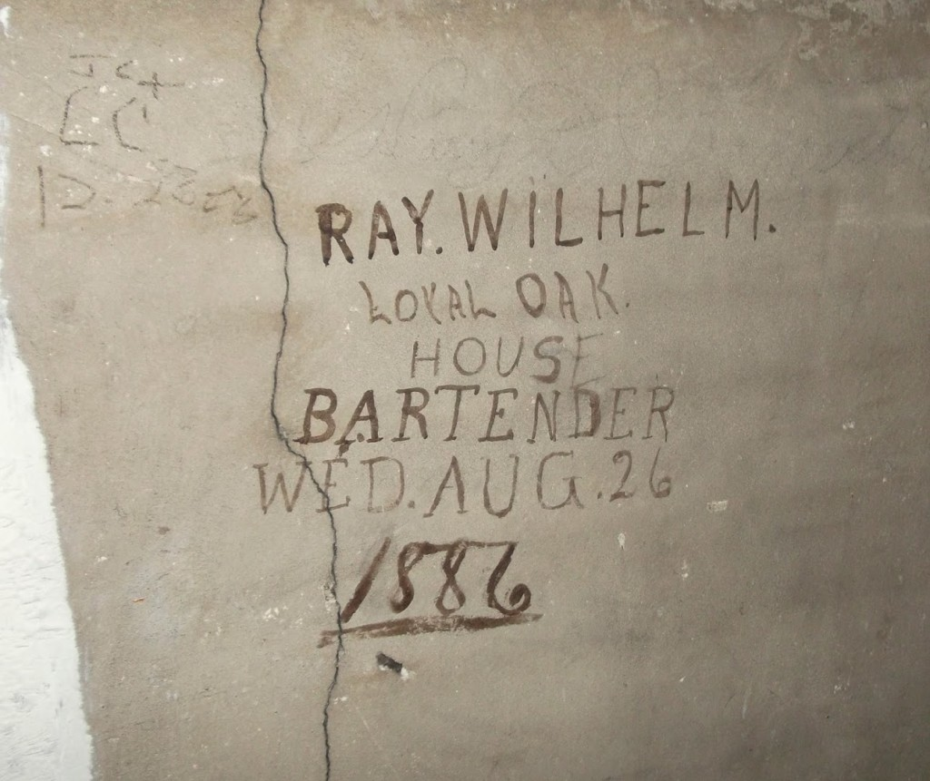 Graffito left on an upstairs wall by the doomed bartender Ray Wilhelm. (HERALD PHOTO/Ryan LaBo)