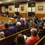 Community members pack the gallery at the legislative session of the Barberton City Council to hear the vote on the proposed lease of Tuscora Park land by Summa Health. The proposal passed, 7-1. (HERALD PHOTO/Ryan LaBo)